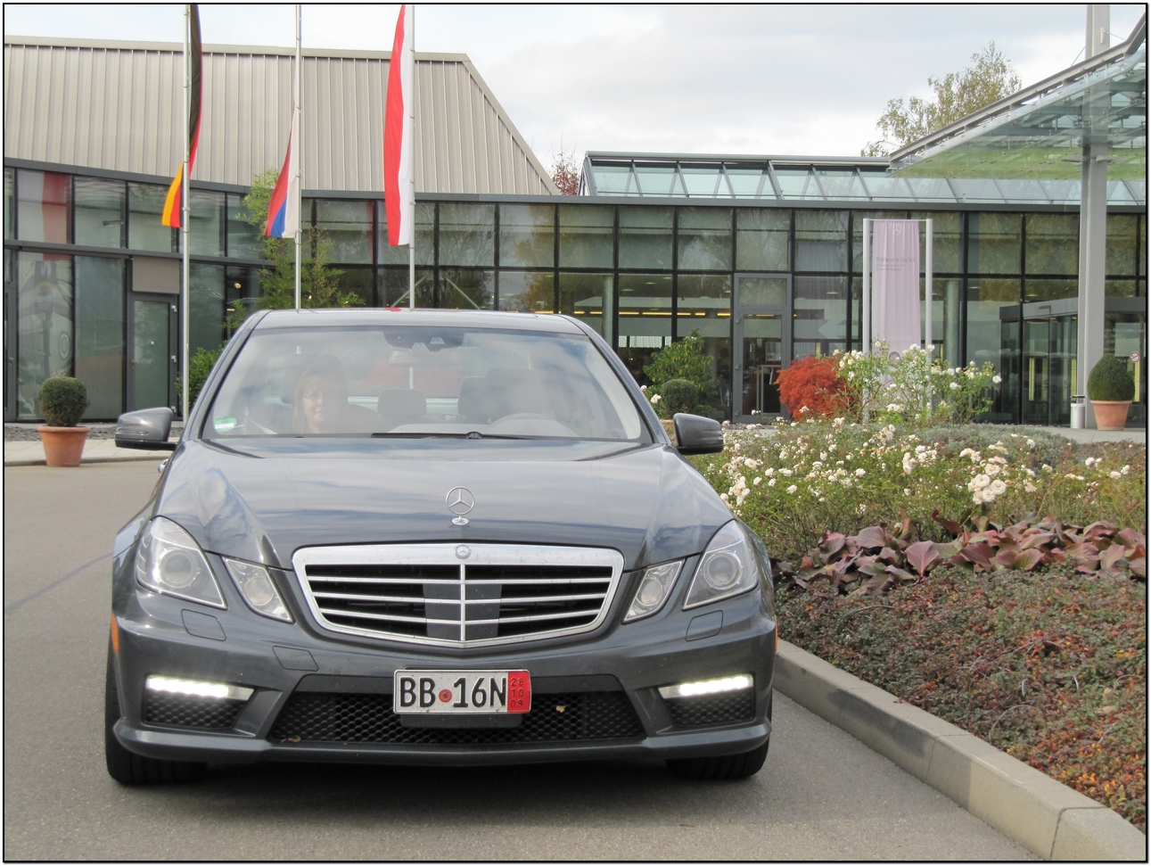 2010 e63 amg outside the mercedes benz delivery center in for Mercedes benz european delivery